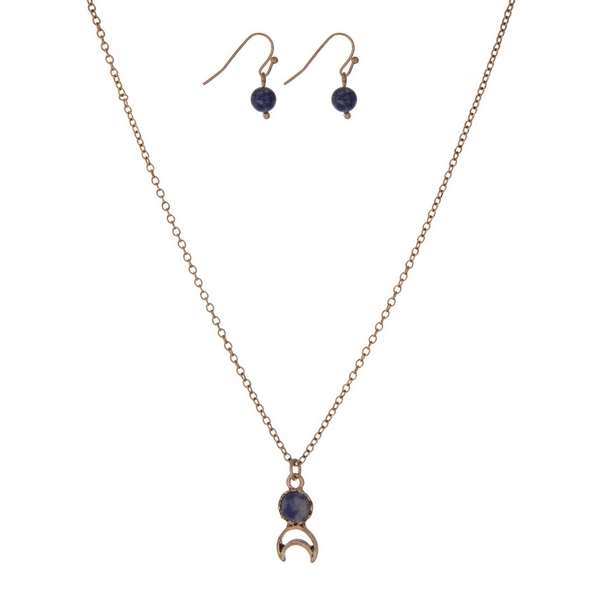 "Dainty gold tone necklace set with a blue stone, a crescent cutout, and matching fishhook earrings. Approximately 16"" in length."