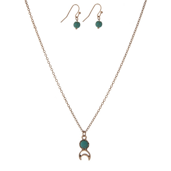 """Dainty gold tone necklace set with a turquoise stone, a crescent cutout, and matching fishhook earrings. Approximately 16"""" in length."""
