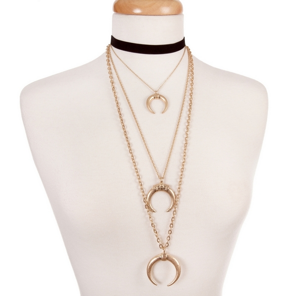 """Black and gold tone, layered choker with crescent pendants. Approximately 12"""" in length."""