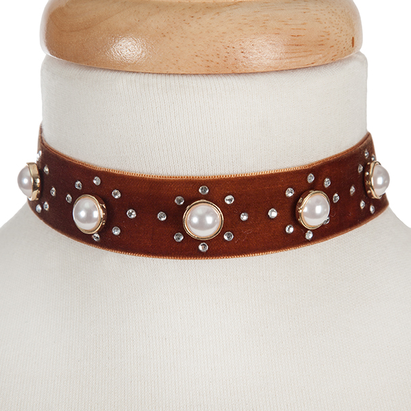 "Brown velvet choker with pearl beads and clear rhinestone accents. Approximately 12"" in length and 1"" in width."