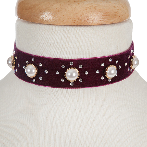 "Burgundy velvet choker with pearl beads and clear rhinestone accents. Approximately 12"" in length and 1"" in width."