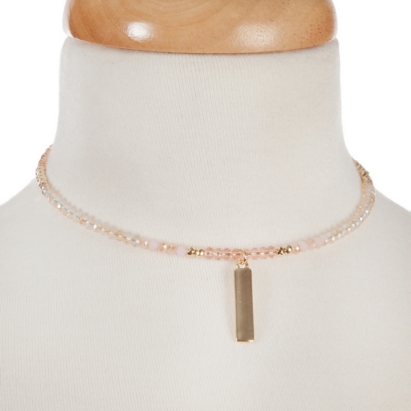 """Pink and gold tone beaded coil choker with a bar pendant. Approximately 12"""" around."""