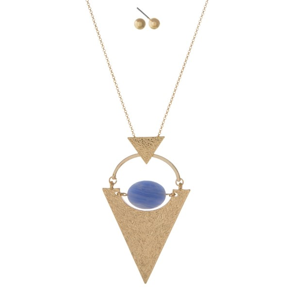"Gold tone necklace set with a hammered triangle pendant and light blue faceted bead. Approximately 32"" in length."