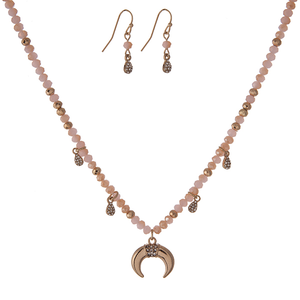 """Dainty gold tone necklace set with light pink faceted beads and a crescent pendant and matching fishhook earrings. Approximately 16"""" in length."""