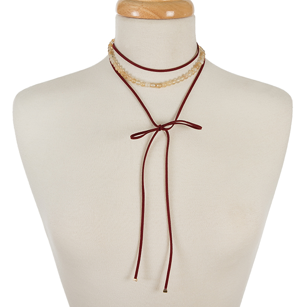"""Burgundy faux suede and beige natural stone, beaded wrap choker with gold tone accents. Approximately 12"""" in length."""