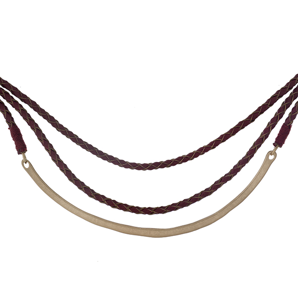 """Burgundy braided, faux leather necklace with a gold tone curved bar. Approximately 14"""" in length."""