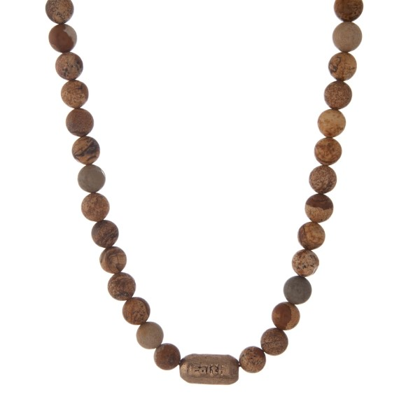 """Picture jasper beaded necklace with a gold tone bead, stamped with """"Faith."""" Approximately 16"""" in length."""