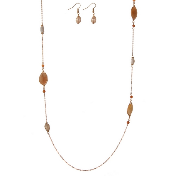 """Gold tone necklace set with neutral colored stone stationaries and matching fishhook earrings. Approximately 32"""" in length."""