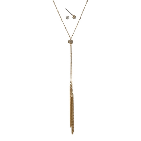 """Gold tone necklace set with clear rhinestone accents and metal tassels. Approximately 30"""" in length."""