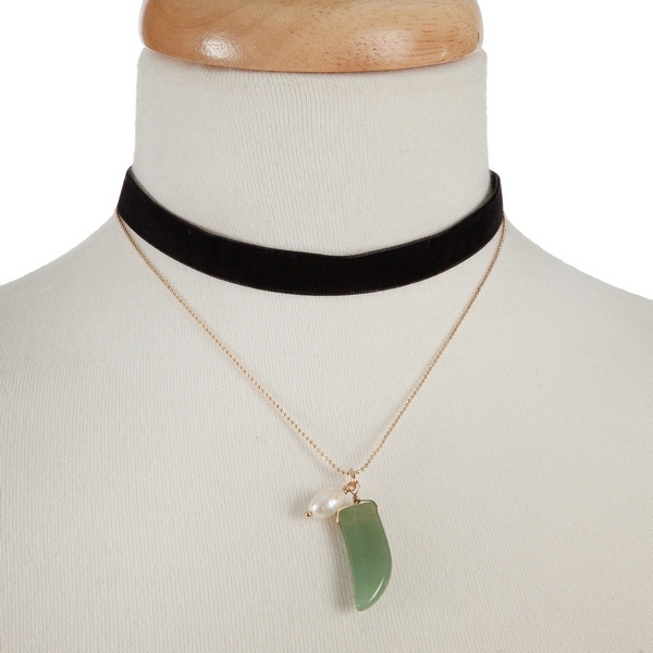 """Black faux suede and gold tone choker with a green horn pendant. Approximately 12"""" in length."""