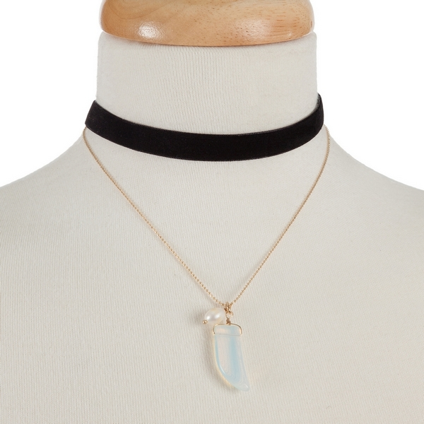"""Black faux suede and gold tone choker with an opal horn pendant. Approximately 12"""" in length."""