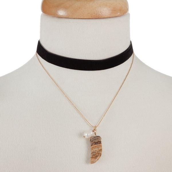 """Black faux suede and gold tone choker with a picture jasper horn pendant. Approximately 12"""" in length."""