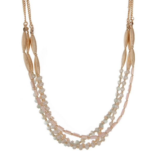 """Gold tone multi strand necklace with mint, peach and ivory beads. Approximately 16"""" in length."""