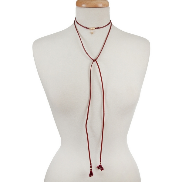 """Burgundy faux suede, open wrap choker with a gold tone star pendant. Approximately 60"""" in length."""