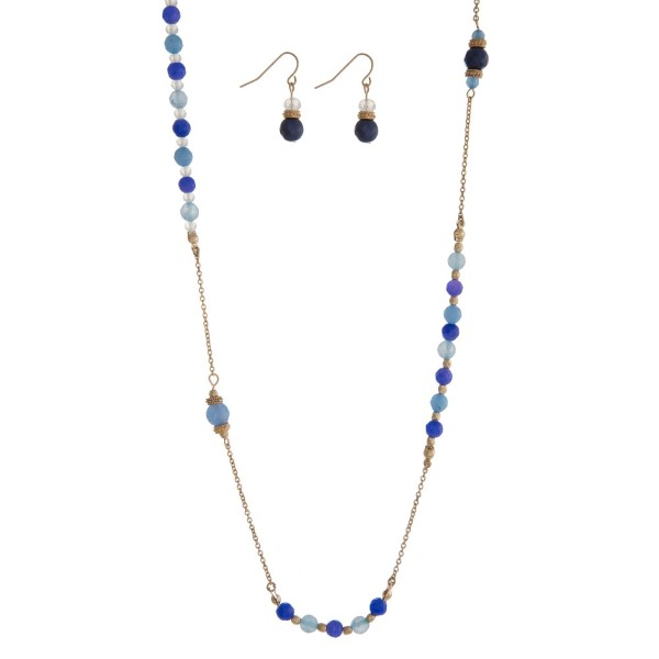 "Gold tone necklace with blue and light blue beaded accents. Approximately 36"" in length."