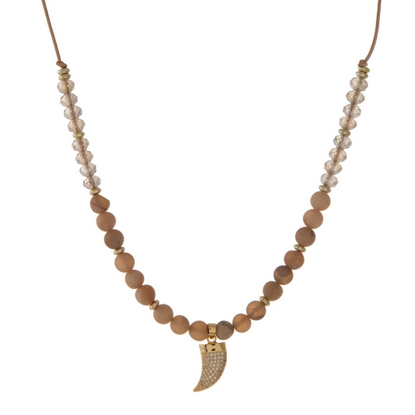 "Brown cord necklace with peach druzy natural stone beads, topaz faceted beads and a gold tone horn pendant. Approximately 16"" in length. Handmade in the USA."