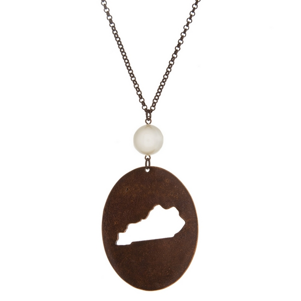 """Burnished copper tone necklace with a Kentucky cutout pendant accented by a pearl bead. Approximately 30"""" in length. Oval pendant is approximately 2.5"""" tall."""