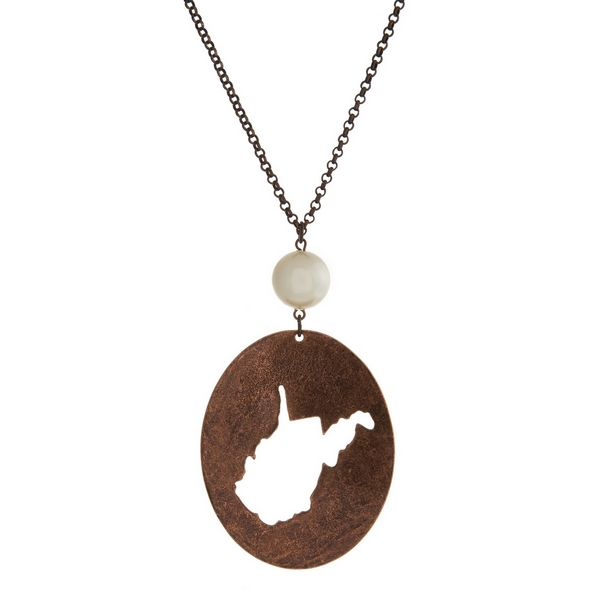 """Burnished copper tone necklace with a West Virginia cutout pendant accented by a pearl bead. Approximately 30"""" in length. Oval pendant is approximately 2.5"""" tall."""