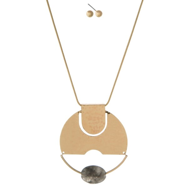 """Gold tone necklace set with a hammered circle pendant and gray faceted bead. Approximately 32"""" in length."""