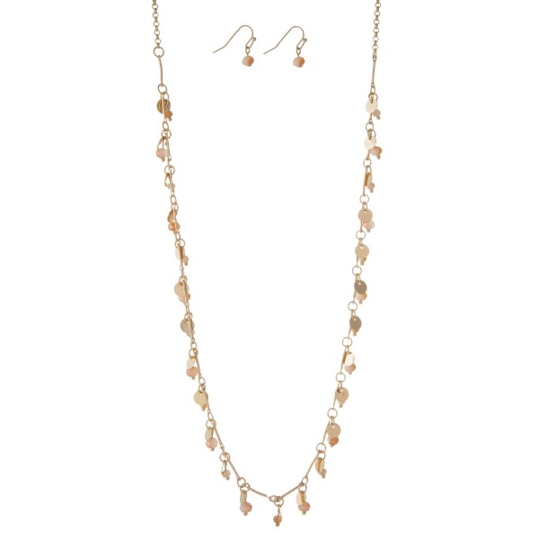 """Dainty gold tone necklace with metal circle and champagne bead charms, and matching fishhook earrings. Approximately 27"""" in length."""
