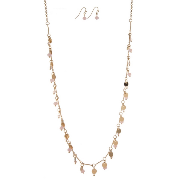 """Dainty gold tone necklace with metal circle and pale pink bead charms, and matching fishhook earrings. Approximately 27"""" in length."""