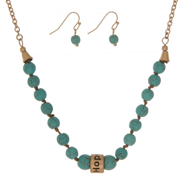 "Turquoise, natural stone beaded necklace with a gold tone bead stamped with ""Hope"" and matching fishhook earrings."