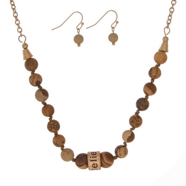 """Picture jasper, natural stone beaded necklace with a gold tone bead stamped with """"Believe"""" and matching fishhook earrings."""
