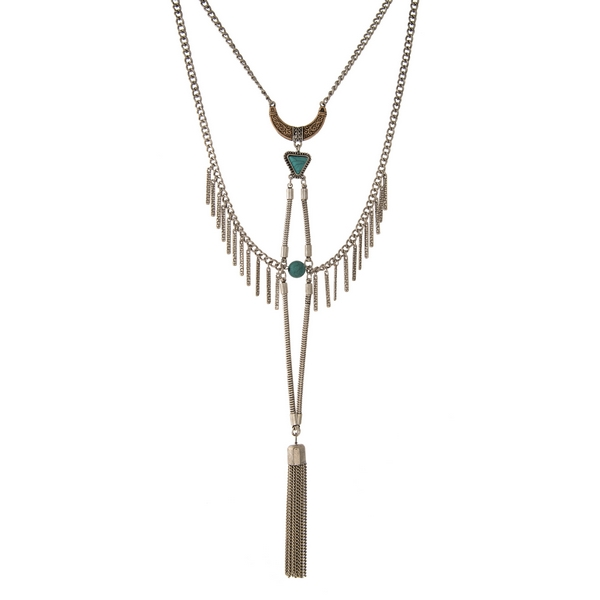 "Silver tone statement necklace with turquoise stones and a chain tassel. Approximately 18"" in length."