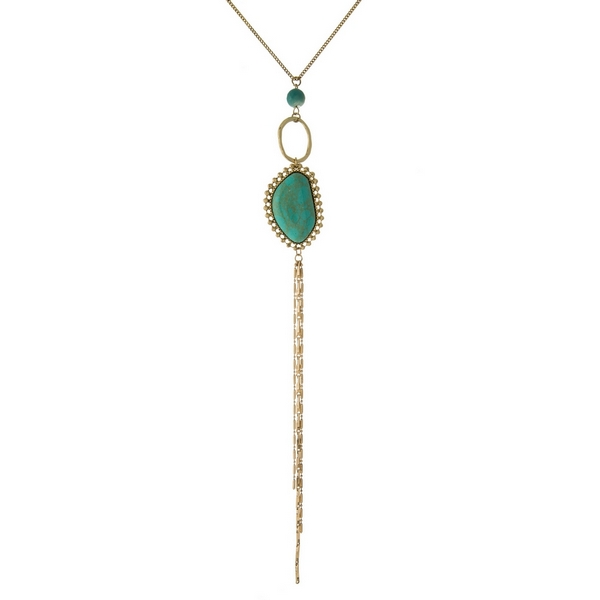"Gold tone necklace with a turquoise stone pendant, a mint bead and a chain tassel. Approximately 24"" in length."