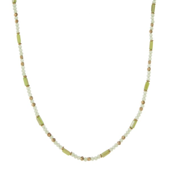 """Light green and gold tone beaded wrap bracelet that can also be worn as a necklace. Approximately 30"""" in length."""