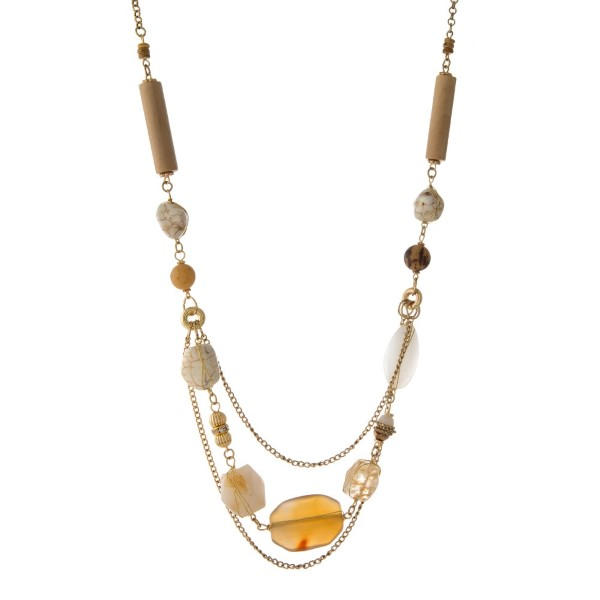 "Gold tone necklace with ivory, beige, and white natural stones. Approximately 32"" in length."