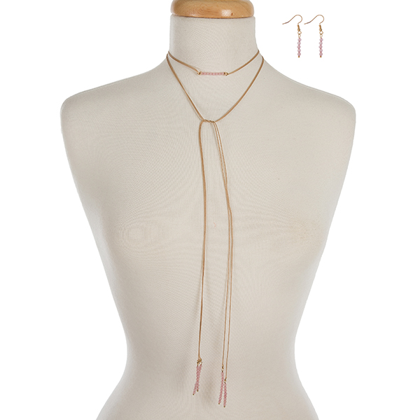 """Tan waxed cord wrap necklace set displaying light pink beads and matching fishhook earrings. Approximately 52"""" in length."""