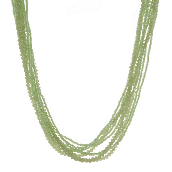"""Multi strand necklace with light green beads. Approximately 26"""" in length."""