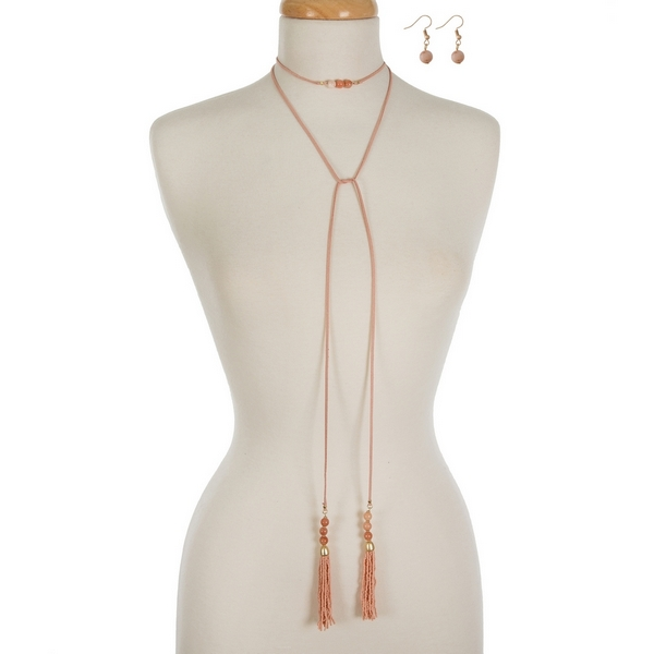 "Peach faux suede wrap necklace featuring peach beaded tassels on each end and matching fishhook earrings. Approximately 60"" in length."