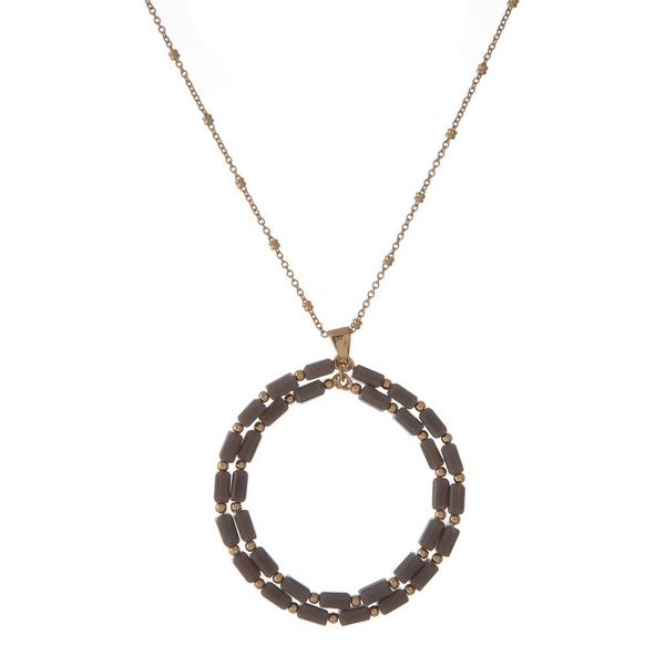"""Gold tone necklace featuring a gray beaded, open circle pendant. Approximately 32"""" in length."""