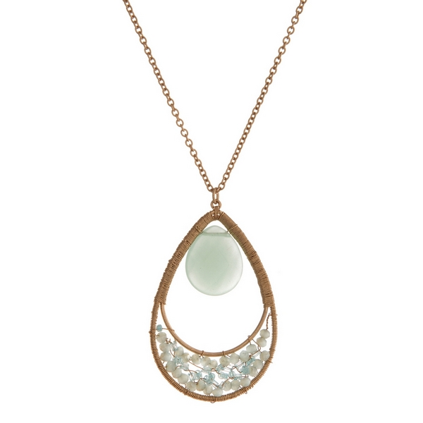 """Gold tone necklace with a mint green natural stone and beaded teardrop pendant. Approximately 32"""" in length."""