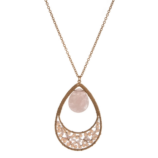 """Gold tone necklace with a pale pink natural stone and beaded teardrop pendant. Approximately 32"""" in length."""