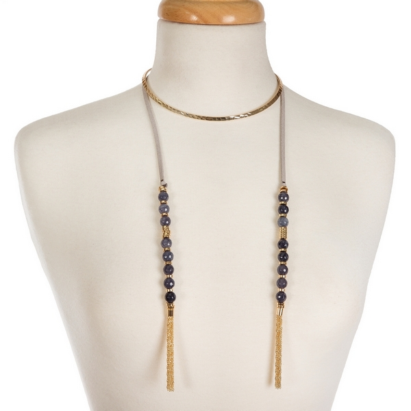 """Gold tone open metal choker featuring gray faux suede pieces with gray natural stone beads and chain tassels. Approximately 16"""" in length."""
