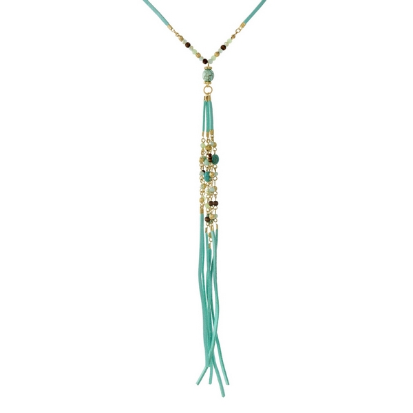 """Mint green faux suede necklace featuring wooden and turquoise beads and a tassel pendant. Approximately 20"""" in length."""