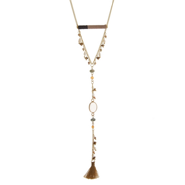 "Gold tone necklace with a gray and taupe thread wrapped bar and a fabric tassel pendant. Approximately 28"" in length."