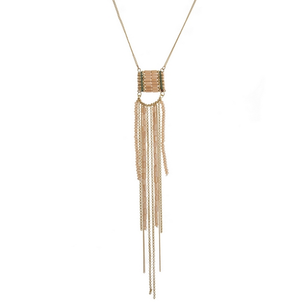 "Gold tone necklace with a topaz beaded tassel pendant. Approximately 30"" in length."