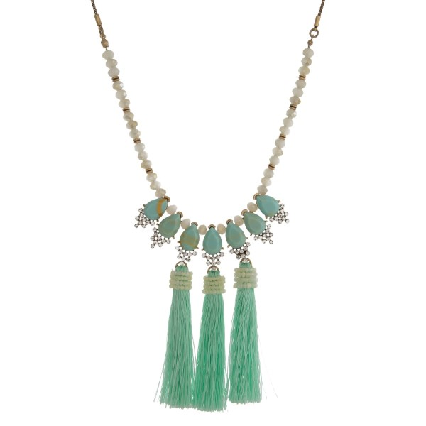 "Gold tone necklace with mint green stones and tassels. Adjustable from 16"" to 30"" in length."