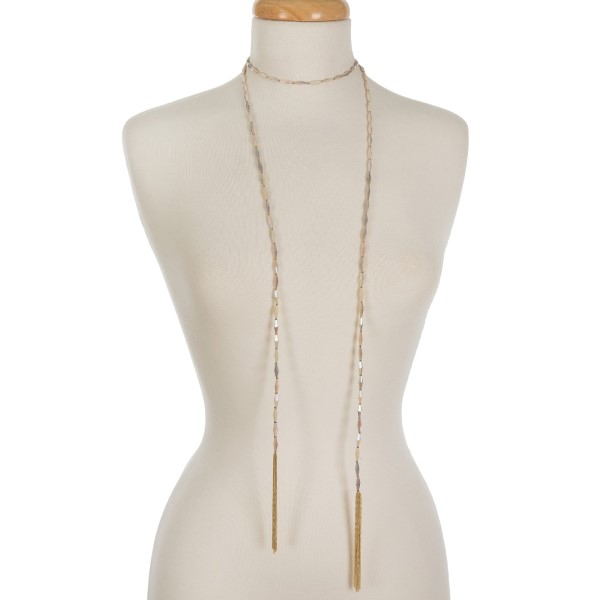 "Ivory and gold tone beaded wrap necklace featuring chain tassels on the ends. Approximately 60"" in length."