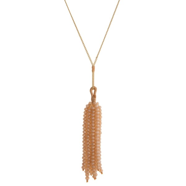 "Dainty gold tone necklace with a topaz faceted bead tassel. Approximately 28"" in length."
