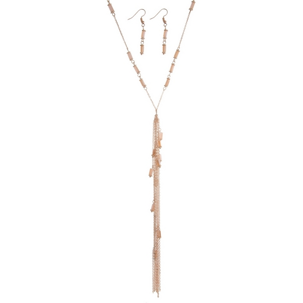 "Rose gold tone necklace set featuring pink beads, a chain tassel and matching fishhook earrings. Approximately 34"" in length."
