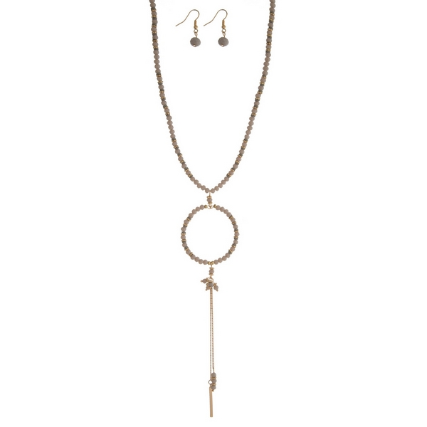 """Gold tone and gray beaded necklace set with an open circle beaded pendant and matching fishhook earrings. Approximately 28"""" in length."""
