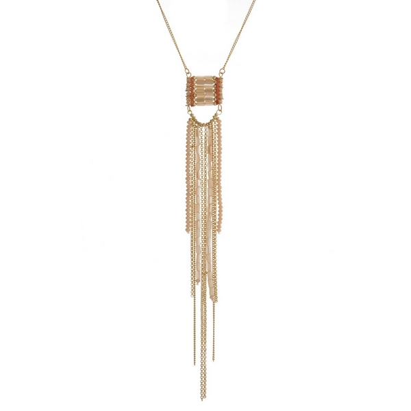 "Gold tone necklace with a peach beaded tassel pendant. Approximately 30"" in length."