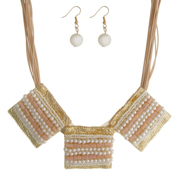 "Tan cord statement necklace with three pale pink and pearl beaded squares and matching fishhook earrings. Approximately 16"" in length."