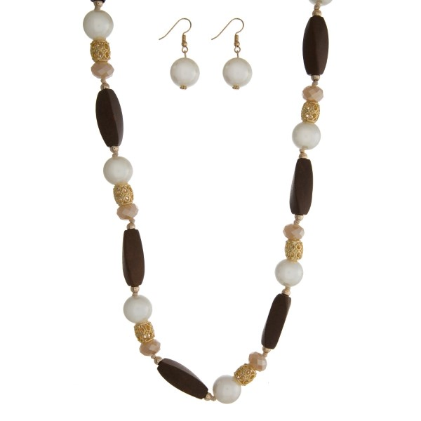 "Gold tone necklace set with wooden beads, cream pearl beads, and matching fishhook earrings. Approximately 40"" in length."