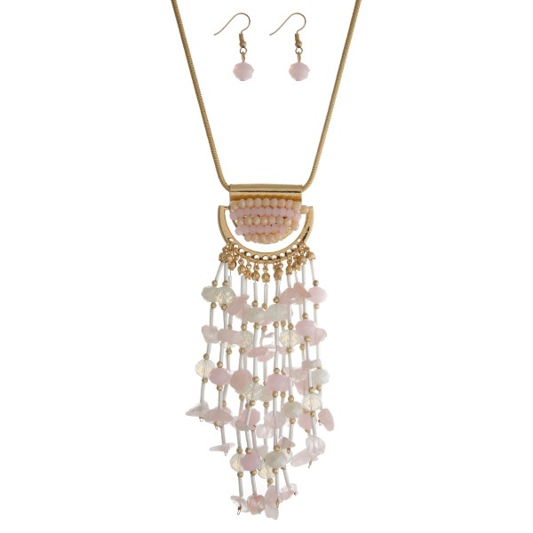 """Gold tone necklace set with a pale pink, opal and ivory beaded tassel pendant and matching fishhook earrings. Approximately 28"""" in length."""